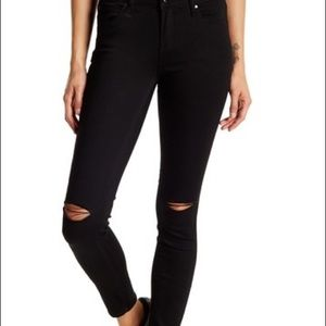 Black articles of society ripped knee denim jeans